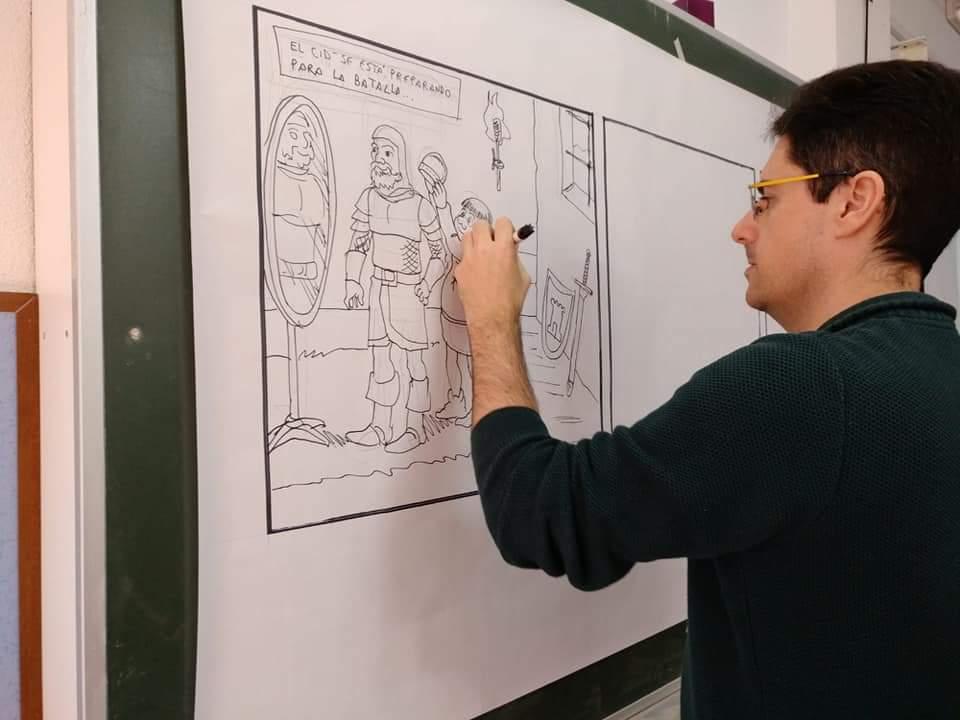 Santi llevando a cabo el taller de cómic